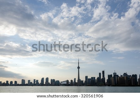 Skyline of Toronto over Ontario Lake at sunset - stock photo