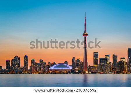 Skyline of Toronto over Ontario Lake at twilight - stock photo