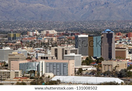 Skyline of Tucson Arizona, flanked by the Catalina mountains - stock photo