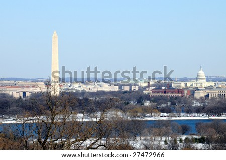 Skyline of Washington DC in winter, including the Washington Monument, the National Mall and the Capitol, as seen from Arlington, Virginia, across the Potomac River. - stock photo