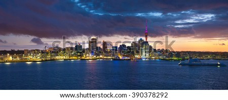 Skyline photo of the biggest city in the New Zealand, Auckland. Panoramic photo was taken after sunset across the bay