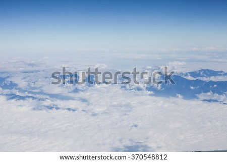 Skyline View above the Clouds from Airplane - stock photo