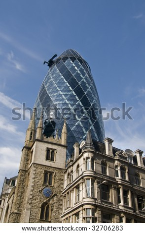 Skyscraper Axe tower in London lit beautifully by evening summer sunshine - stock photo