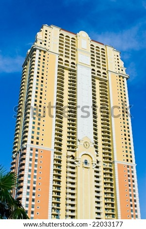 skyscraper detail against blue sky in South Florida - stock photo