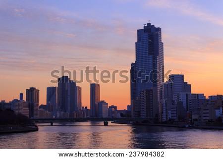 Skyscraper in Tokyo at dusk - stock photo