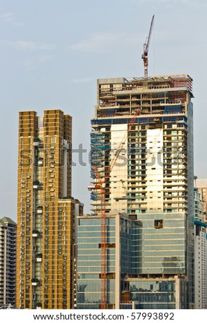 Skyscraper Office Tower Under Construction in Bangkok Thailand - stock photo