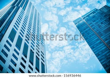 Skyscraper on the sky. Blue filter - stock photo
