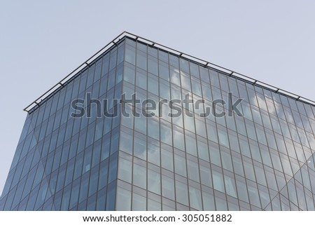 skyscraper windows reflections with clouds