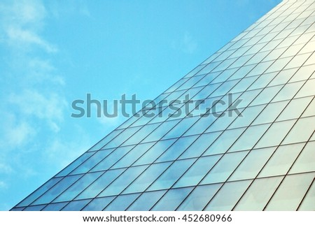Skyscraper with glass facade. Modern building.