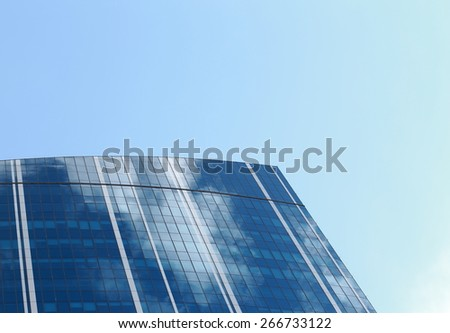 Skyscraper with glass facade. Modern building. Concepts of economics, financial, business, future. Copy space for text.