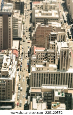 Skyscrapers and everyday people life in the business district of Johannesburg - Aerial view of modern buildings of the skyline in South Africa biggest city - Tilted shift defocusing - stock photo