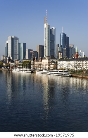 skyscrapers at financial district, Main river and tourist boats at Frankfurt, vertical