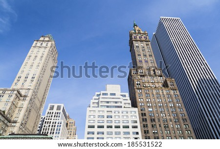 Skyscrapers at Grand Army Plaza near Central Park in New York with deep blue sky - stock photo