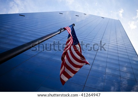 Skyscrapers in New York City with American flag - stock photo
