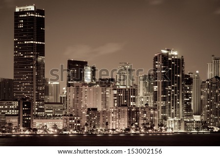 Skyscrapers lit up at dusk in a city, Miami, Miami-Dade County, Florida, USA - stock photo