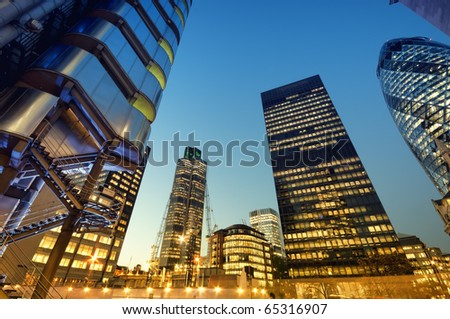 Skyscrapers of City of London at night - stock photo
