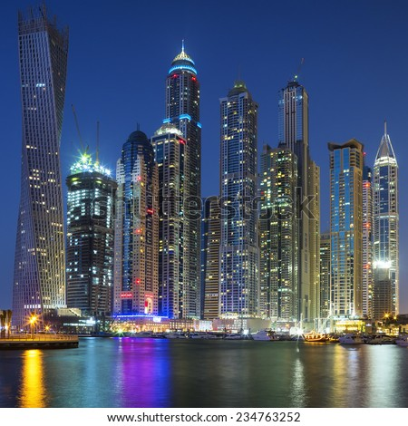 Skyscrapers of Dubai Marina captured in the dusk. - stock photo