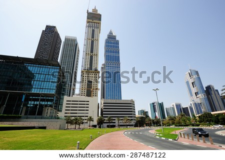 Skyscrapers of Dubai World Trade center rising into the sky.