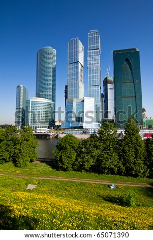 Skyscrapers of Moscow city under blue sky with clouds - stock photo