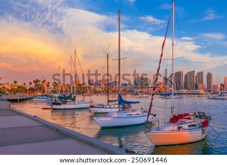 Skyscrapers of San Diego Skyline, waterfront with boats and harbor at sunset, CA - stock photo