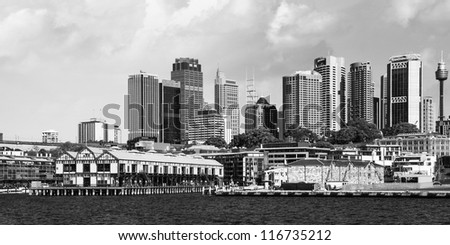 Skyscrapers of Sydney Harbour in Port Jackson - Australia - stock photo