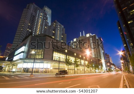 Skyscrapers - office buildings in downtown Beijing at night time - stock photo