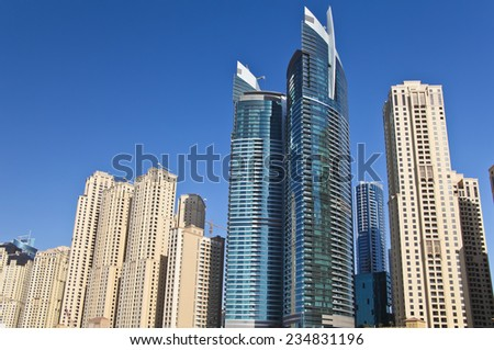 Skyscrapers on the background of the blue sky on sunny day. - stock photo