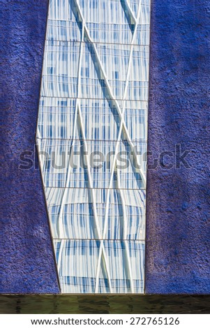 Skyscrapers reflected in the mirrors of a lilac wall - stock photo