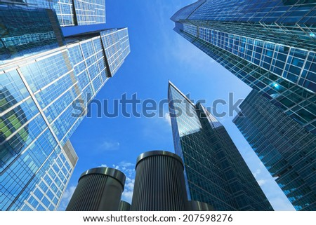Skyscrapers, stretching into the blue sky.  Business centre Moscow-City, Russia. - stock photo