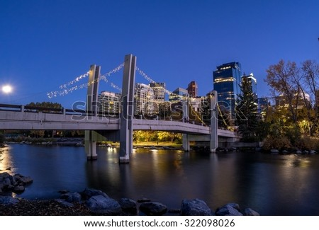 Skyscrapers tower over urban park space in the city of Calgary along the world famous Bow River. - stock photo
