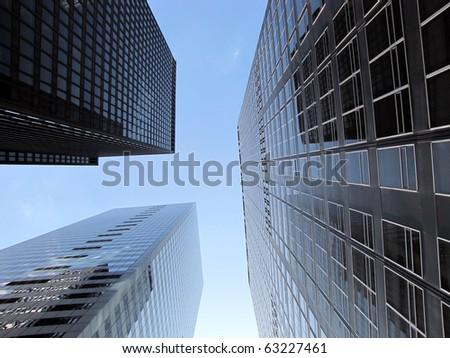 Skyscrapers under blue sky - stock photo