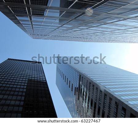 Skyscrapers under blue sky - stock photo