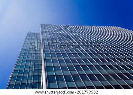 Skyscrapers view with blue sky .  office buildings. modern glass silhouettes of skyscrapers