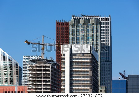 Skyscrapers with the construction of a new office building - stock photo