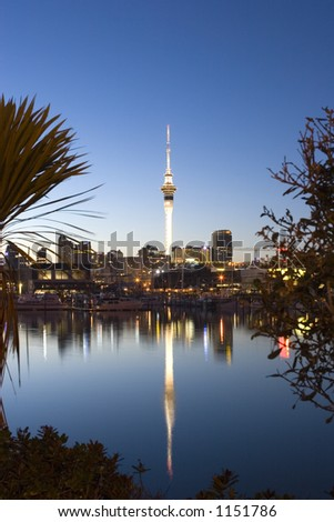Skytower reflected in the calm sea - stock photo