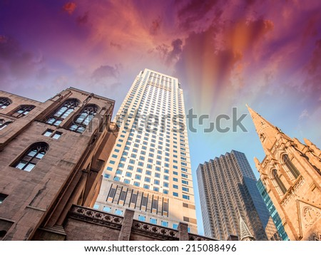 Skyward view of city buildings. - stock photo