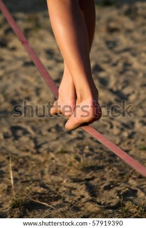 Slackline balance rope over sand - stock photo
