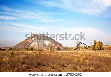 Slagheap and mine in ukrainian steppe - stock photo
