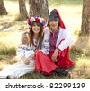 Slav girl with wreath and young cossack at nature. - stock photo