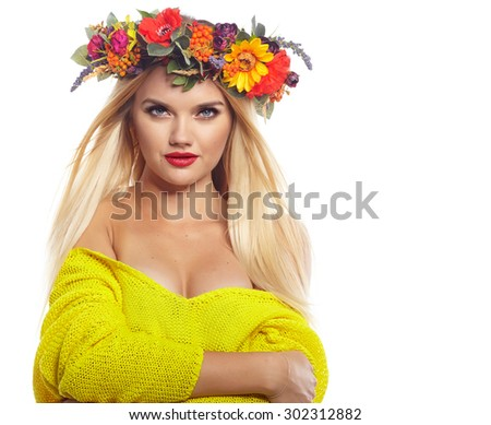 Slavic blonde girl in the flowers wreath