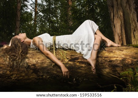 Slavonian girl in the traditional suit in the deep forest