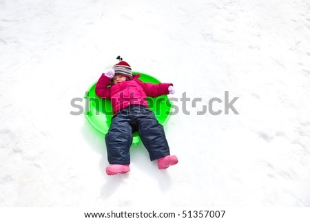 Sled refers to a smaller vehicle  and often one that is pulled by a human or propelled only by gravity. - stock photo