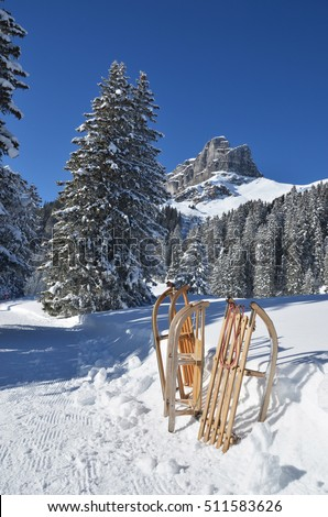 Sledges against snowy Alps