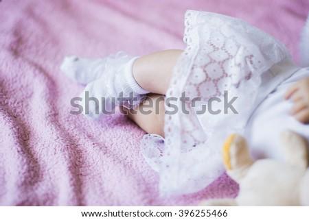 sleeping baby,baby's feet, socks, dress white - stock photo