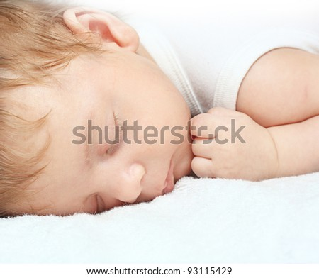 Sleeping Baby Boy on a White Blanket - stock photo