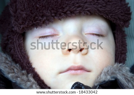 Sleeping baby boy winter