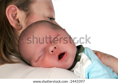Sleeping baby in his mother's arms, only 15 days old