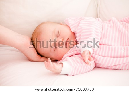 sleeping baby in striped toddlers close up