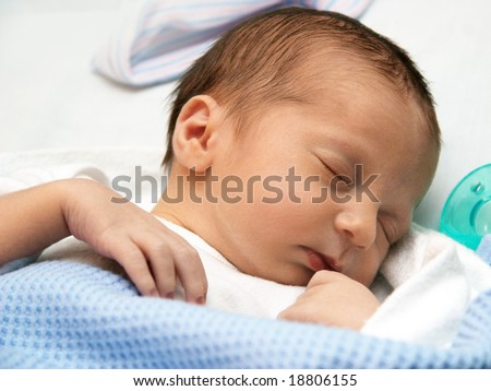 Sleeping baby on his first day - stock photo