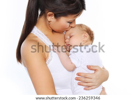 Sleeping baby on the hands mother - stock photo